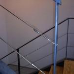 Detall del terminal del cable en la barana