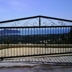 Porta de parcel·la corredissa de ferro