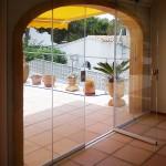 Vista interior de cortina de cristal Seeglass solapada