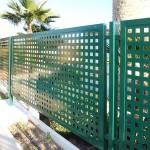 Vallat amb xapa perforada galvanitzada i lacat color verd