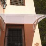 Marquesina soportes de hierro lacado blanco y policarbonato blanco